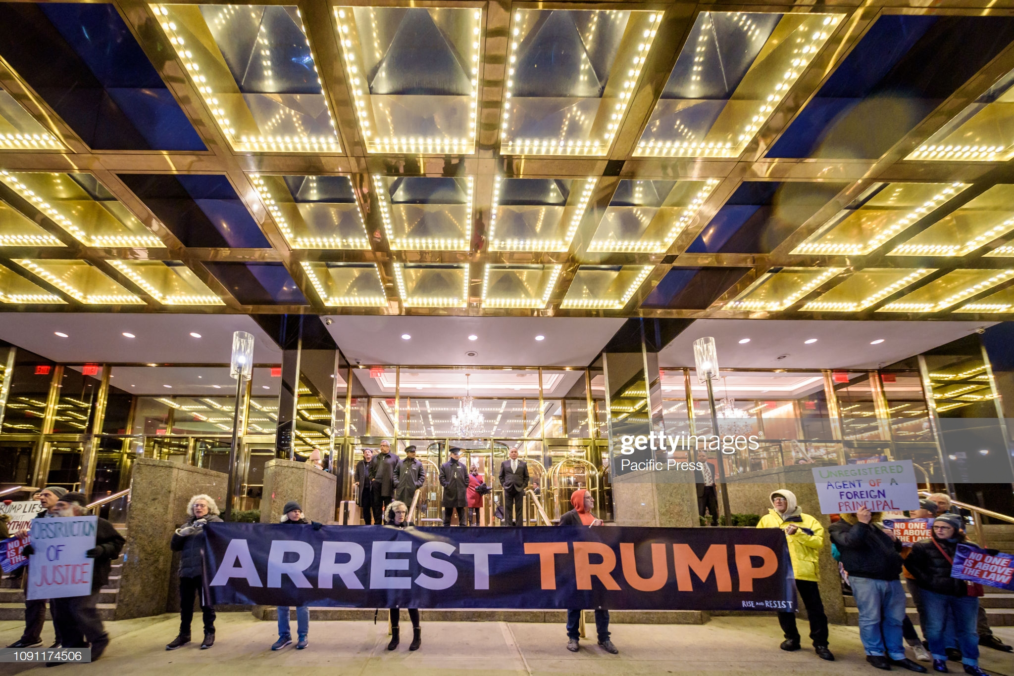 "TRUMP INTERNATIONAL HOTEL AT COLUMBUS CIRCLE, NEW YORK, UNITED STATES - 2019/01/29: Members of the activist group Rise and Resist held an ""Arrest Trump"" protest outside the Trump International Hotel at Columbus Circle in Manhattan the day when the State of the Union was supposed to be delivered by Trump before the government shutdown. Rise and Resist demands the arrest of Trump for his multiple serious crimes against the people of the United States and other countries. (Photo by Erik McGregor/Pacific Press/LightRocket via Getty Images)"