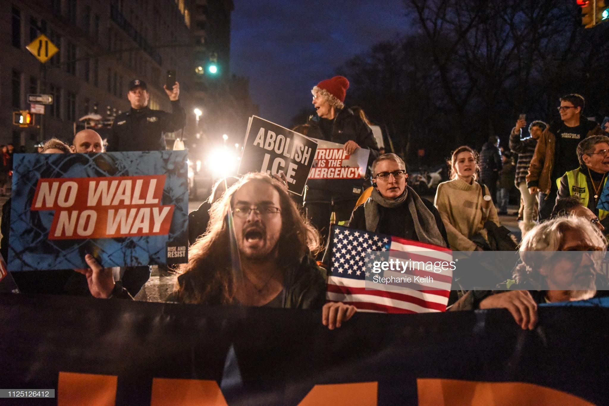 NEW YORK, NY - FEBRUARY 15: People affiliated with the protest group, Rise and Resist, block the street in front of Trump International Hotel on February 15, 2019 in New York City. The group is protesting U.S. President Donald Trump's declaration of a National Emergency in order to build his proposed border wall. (Photo by Stephanie Keith/Getty Images)