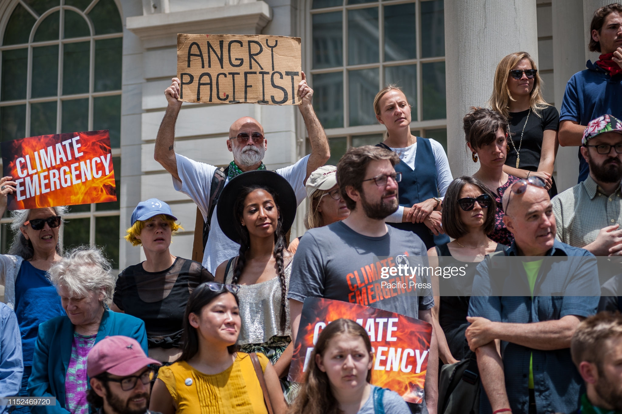CITY HALL, NEW YORK, UNITED STATES - 2019/06/24: Climate activists and NYC Council members holding a banner as they held a rally on the steps of City Hall, New York, in support of Resolution 0864-2019 which, if passed, would declare a climate emergency and call for an immediate emergency mobilization to restore a safe climate. (Photo by Gabriele Holtermann-Gorden/Pacific Press/LightRocket via Getty Images)